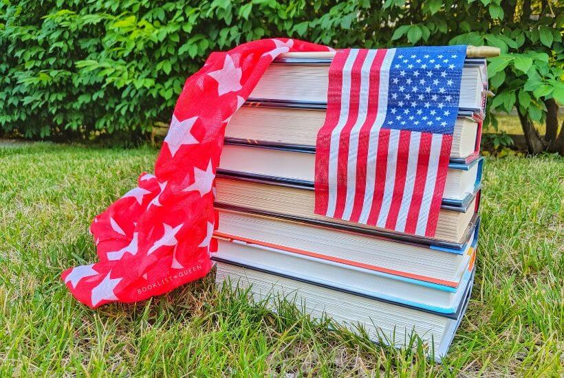 book stack, AMerican flag, red scarf with stars