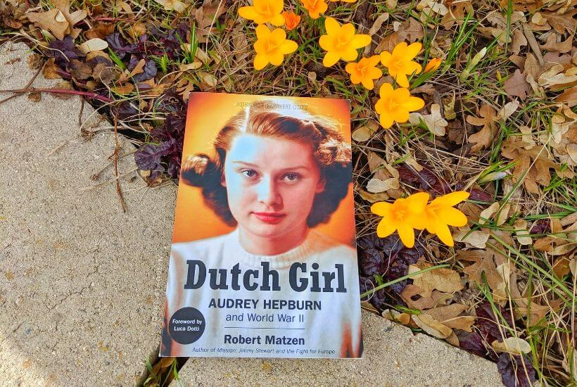 book cover Dutch Girl by Robert Matzen among yellow crocuses