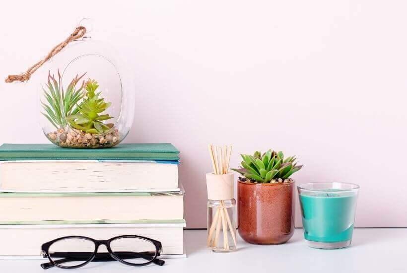 Minimalism Books - bookstack, glasses, plant, candle