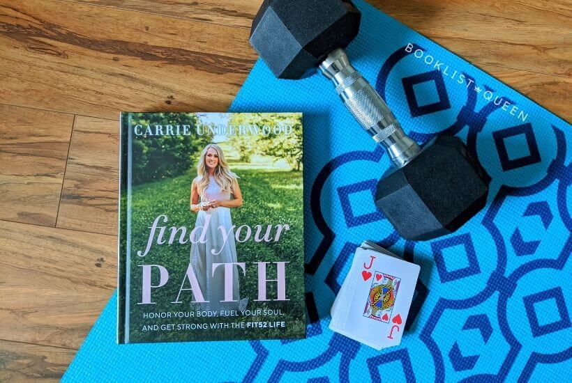 book Find Your Path by Carrie Underwood, blue yoga mat, dumbbell, playing cards