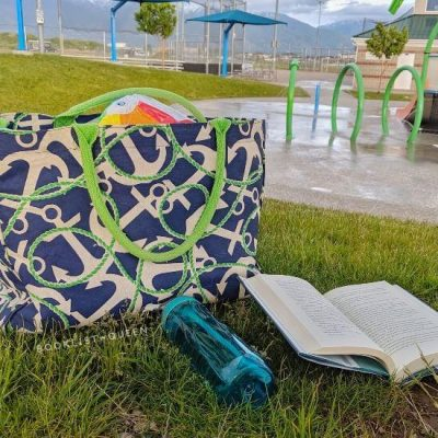Beach bag, open book, splash pad