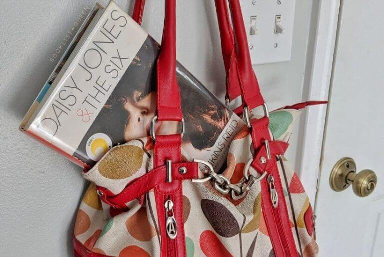 Daisy Jones & The Six inside a purse