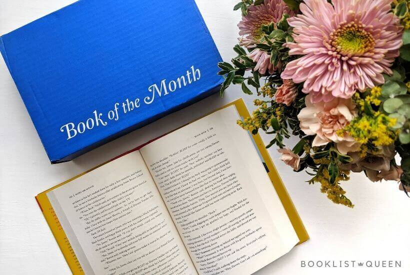 Book of the Month April 2021 selections - blue subscription book box, open book, flowers