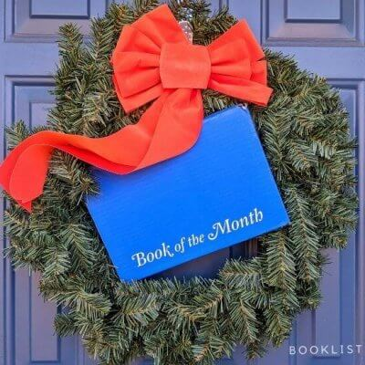 Book of the Month December 2020 Selections - blue subscription book box on Christmas wreath