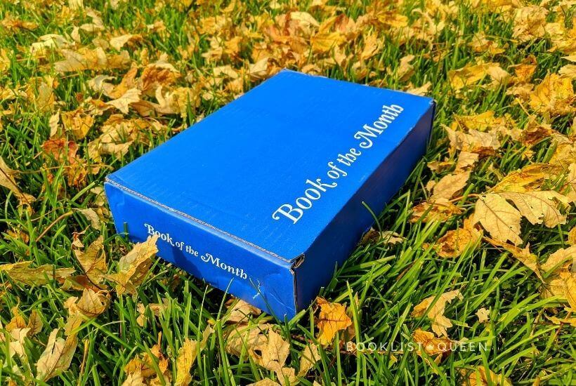 blue Book of the Month box in leaves