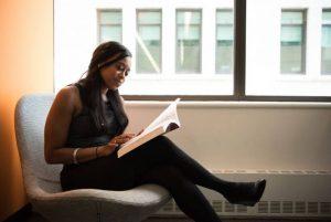 Black girl reading a book