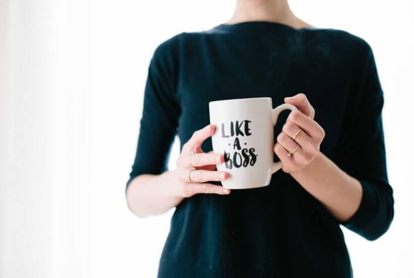 """woman holding mug saying """"Like A Boss"""""""