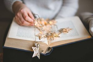 Five Star Books - open book with star lights