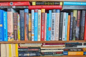 How to Declutter Books - A Cluttered Bookshelf