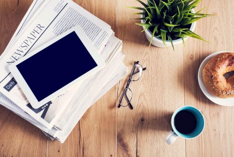 newsletter, tablet, glasses, plant, bagel, coffee mug