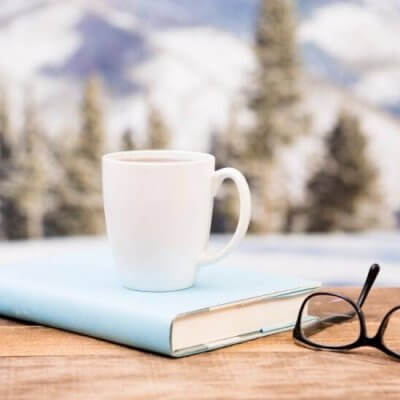 book, coffee mug, glasses, mountains, snow