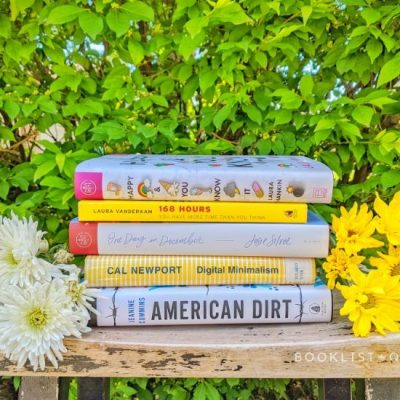 book stack - white and yellow books with daisies