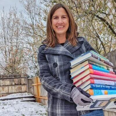 Rachael holding stack of books in the snow